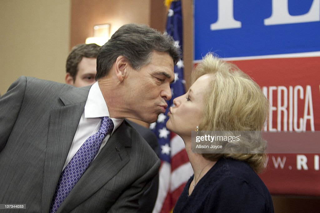 Republican presidential candidate, Texas Gov. <a gi-track='captionPersonalityLinkClicked' href=/galleries/search?phrase=Rick+Perry+-+Politician&family=editorial&specificpeople=175872 ng-click='$event.stopPropagation()'>Rick Perry</a> kisses his wife Antia at the end of a news conference at Hyatt Place January 19, 2012 in North Charleston, South Carolina. Perry, who placed fifth in Iowa and New Hampshire, announced his withdrawal from the presidential race and endorsed former Speaker of the House Newt Gingrich.