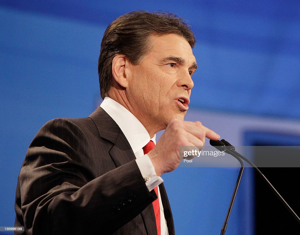 Republican presidential candidate Texas Gov. Rick Perry, speaks debate at the Sioux City Convention Center on December 15, 2011 in Sioux City, Iowa. The GOP contenders are in the final stretch of campaigning in Iowa where the January 3rd caucus is the first test the candidates must face before becoming the Republican presidential nominee.