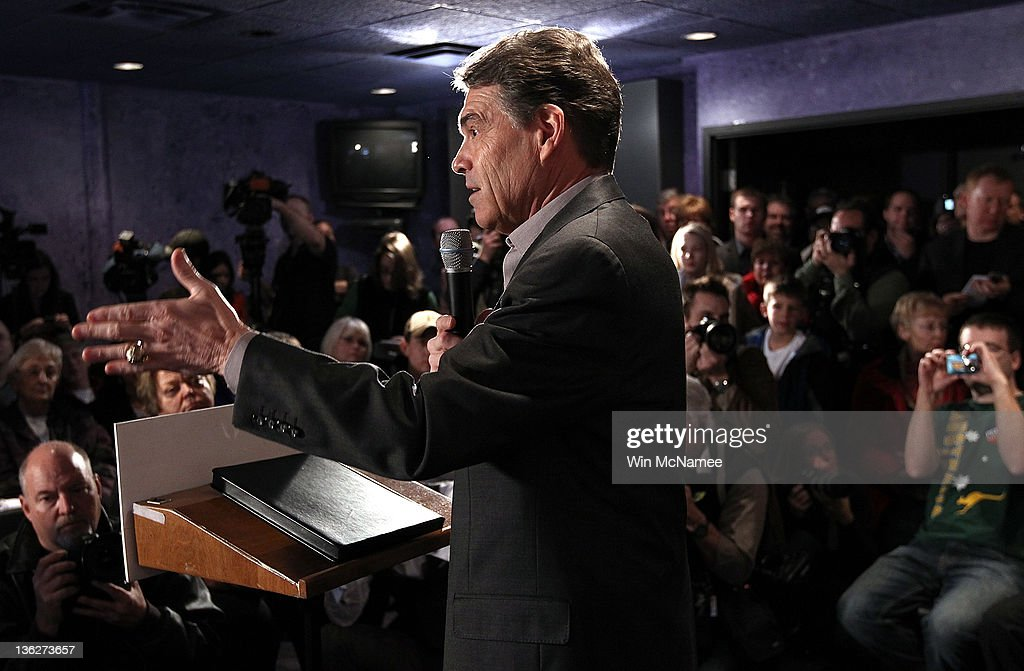 Republican presidential candidate Texas Gov. Rick Perry speaks to Iowa voters at Doughy Joey's pizza shop December 30, 2011 in Waterloo, Iowa. Four full days of campaigning remain before Iowans vote on January 3rd.