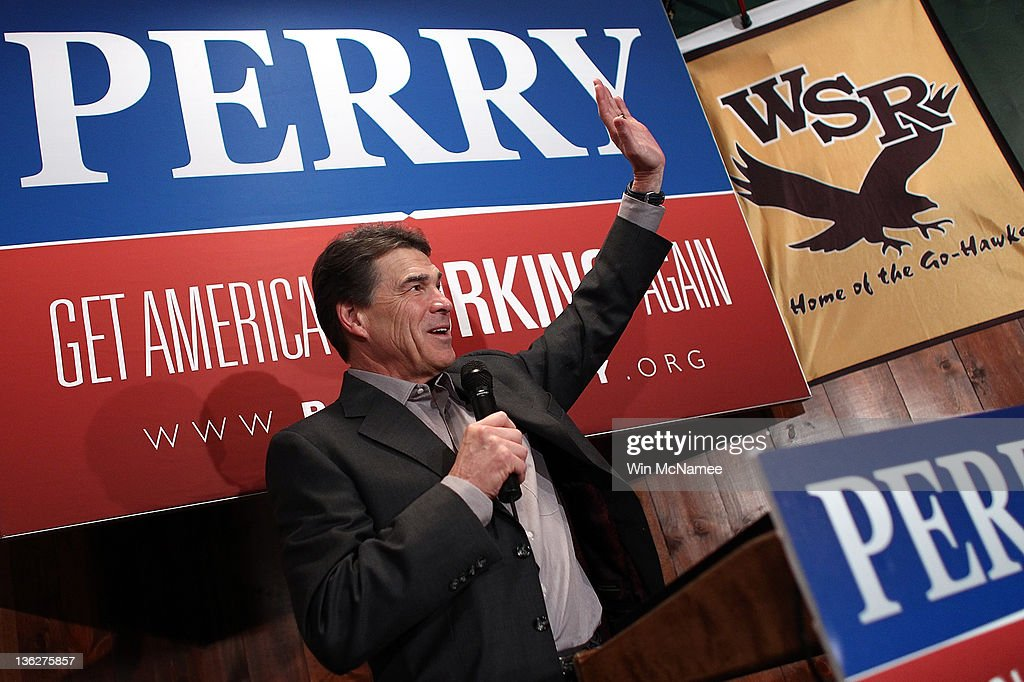 Republican presidential candidate Texas Gov. <a gi-track='captionPersonalityLinkClicked' href=/galleries/search?phrase=Rick+Perry+-+Politician&family=editorial&specificpeople=175872 ng-click='$event.stopPropagation()'>Rick Perry</a> speaks to Iowa voters at The Fainting Goat bar and restaurant December 30, 2011 in Waverly, Iowa. Four full days of campaigning remain before Iowans vote on January 3rd.