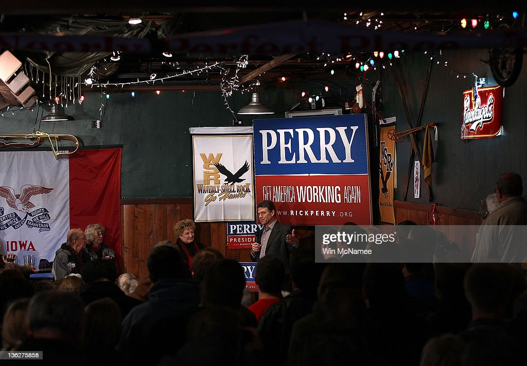 Republican presidential candidate Texas Gov. Rick Perry speaks to Iowa voters at The Fainting Goat bar and restaurant December 30, 2011 in Waverly, Iowa. Four full days of campaigning remain before Iowans vote on January 3rd.