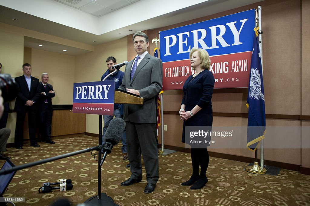 Republican presidential candidate, Texas Gov. <a gi-track='captionPersonalityLinkClicked' href=/galleries/search?phrase=Rick+Perry+-+Politician&family=editorial&specificpeople=175872 ng-click='$event.stopPropagation()'>Rick Perry</a> speaks to the media as his wife Antia looks on at Hyatt Place January 19, 2012 in North Charleston, South Carolina. Perry, who placed fifth in Iowa and New Hampshire, announced his withdrawal from the presidential race and endorsed former Speaker of the House Newt Gingrich.