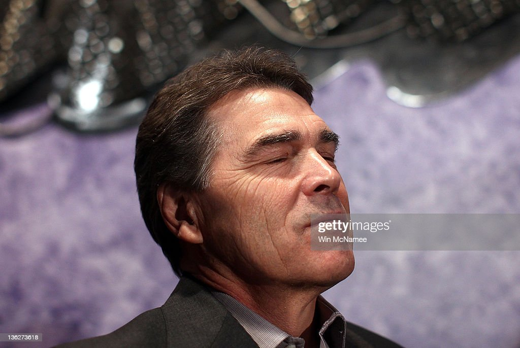 Republican presidential candidate Texas Gov. <a gi-track='captionPersonalityLinkClicked' href=/galleries/search?phrase=Rick+Perry+-+Politician&family=editorial&specificpeople=175872 ng-click='$event.stopPropagation()'>Rick Perry</a> waits to be introduced before speaking to Iowa voters at Doughy Joey's pizza shop December 30, 2011 in Waterloo, Iowa. Four full days of campaigning remain before Iowans vote on January 3rd.