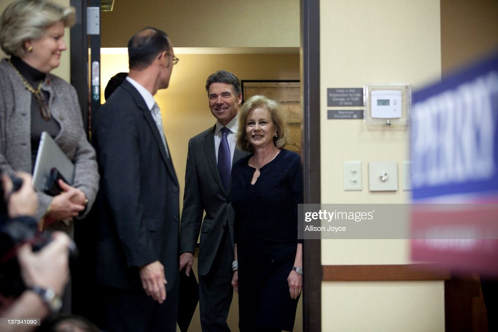 Republican presidential candidate, Texas Gov. <a gi-track='captionPersonalityLinkClicked' href=/galleries/search?phrase=Rick+Perry+-+Politician&family=editorial&specificpeople=175872 ng-click='$event.stopPropagation()'>Rick Perry</a> walks into a news conference with his wife Anita at Hyatt Place January 19, 2012 in North Charleston, South Carolina. Perry, who placed fifth in Iowa and New Hampshire, announced his withdrawal from the presidential race and endorsed former Speaker of the House Newt Gingrich.