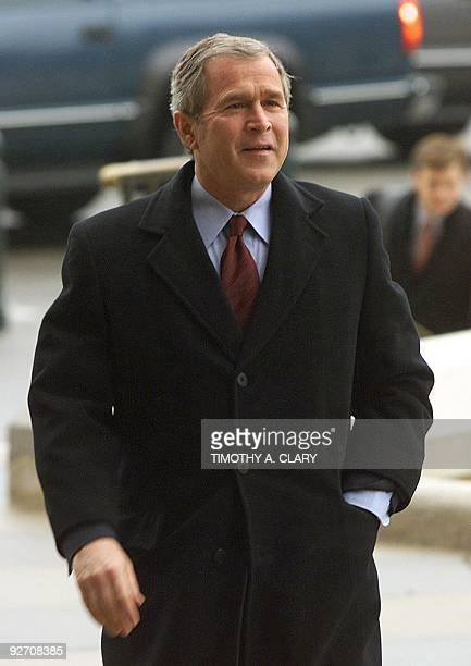 Republican presidential candidate Texas Governor George W Bush arrives at the Texas State Capitol 13 December 2000 the morning after he won a...