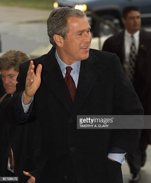 Republican presidential candidate Texas Governor George W Bush waves as he arrives at the Texas State Capitol in Austin 13 December 2000 the morning...