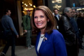 Republican presidential candidate US Rep Michele Bachmann arrives for a meeting with Donald Trump as she enters Trump Tower on 5th Avenue on November...