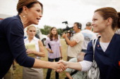 Republican presidential candidate US Rep Michele Bachmann talks to a nurse about repealing 'Obamacare' during a rally at a GOP Picnic August 9 2011...