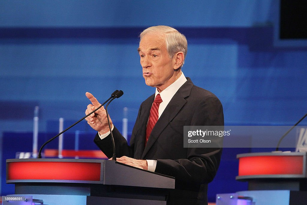 Republican presidential candidate U.S. Rep. <a gi-track='captionPersonalityLinkClicked' href=/galleries/search?phrase=Ron+Paul&family=editorial&specificpeople=2300665 ng-click='$event.stopPropagation()'>Ron Paul</a> (R-TX) answers a question during the Fox News Channel debate at the Sioux City Convention Center on December 15, 2011 in Sioux City, Iowa. The GOP contenders are in the final stretch of campaigning in Iowa where the January 3rd caucus is the first test the candidates must face before becoming the Republican presidential nominee.