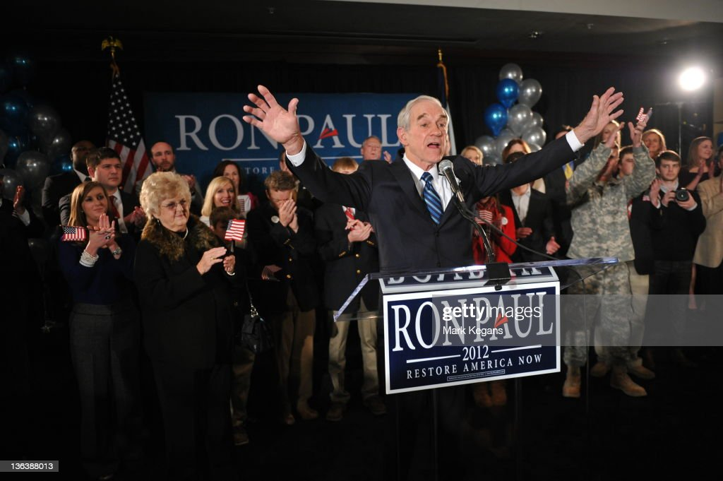 Republican presidential candidate, U.S. Rep. <a gi-track='captionPersonalityLinkClicked' href=/galleries/search?phrase=Ron+Paul&family=editorial&specificpeople=2300665 ng-click='$event.stopPropagation()'>Ron Paul</a> (R-TX) (C) greets supporters at the Courtyard Des Moines Ankeny in Ankeny, Iowa after his third-place finish in the Iowa caucus Tuesday. According to early results U.S. Rep. <a gi-track='captionPersonalityLinkClicked' href=/galleries/search?phrase=Ron+Paul&family=editorial&specificpeople=2300665 ng-click='$event.stopPropagation()'>Ron Paul</a> (R-TX) came in third in the Iowa GOP caucus behind former Massachusetts Gov. Mitt Romney and former U.S. Sen. Rick Santorum, who were neck and neck.