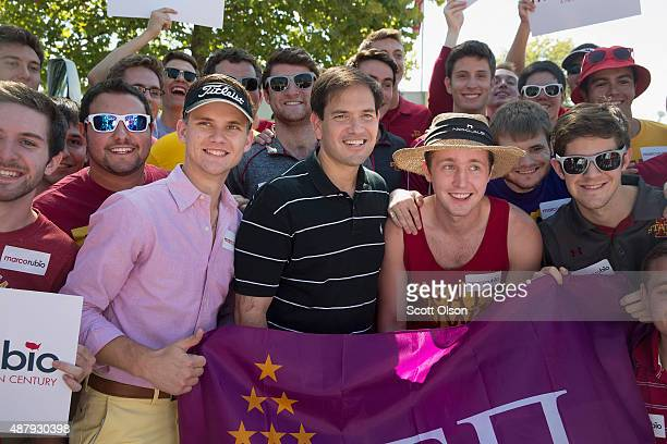 Republican presidential candidate US Sen Marco Rubio poses for a picture with fans outside Jack Trice Stadium before the start of the Iowa State...