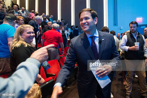 Republican presidential candidate US Sen Marco Rubio shakes hands with supporters after a Americans for Peace Prosperity and Security national...