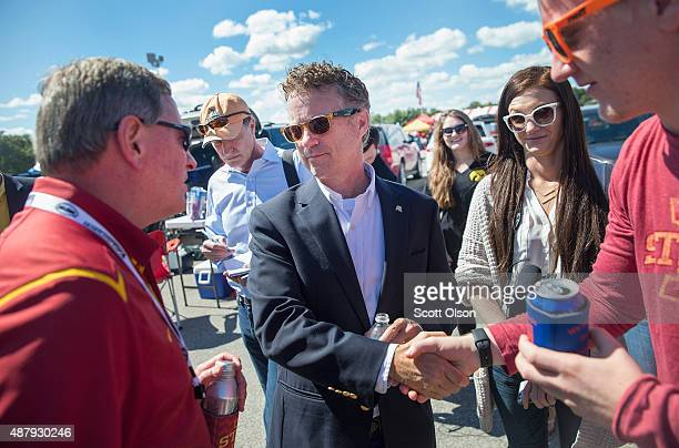 Republican presidential candidate US Sen Rand Paul greets fans outside Jack Trice Stadium before the start of the Iowa State University versus...