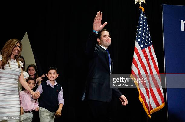 Republican presidential candidate US Senator Marco Rubio walks on stage with his family at a primary night rally on March 15 2016 in Miami Florida...