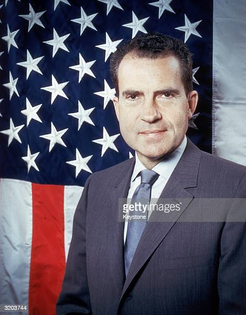 Republican presidential candidate VicePresident Richard Nixon posing in front of the stars and stripes