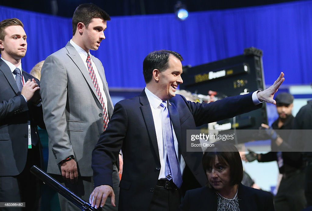 Republican presidential candidate Wisconsin Gov. <a gi-track='captionPersonalityLinkClicked' href=/galleries/search?phrase=Scott+Walker+-+Pol%C3%ADtico&family=editorial&specificpeople=7511934 ng-click='$event.stopPropagation()'>Scott Walker</a> leaves with his family following the first Republican presidential debate hosted by Fox News and Facebook at the Quicken Loans Arena on August 6, 2015 in Cleveland, Ohio. The top ten GOP candidates were selected to participate in the debate based on their rank in an average of the five most recent political polls.