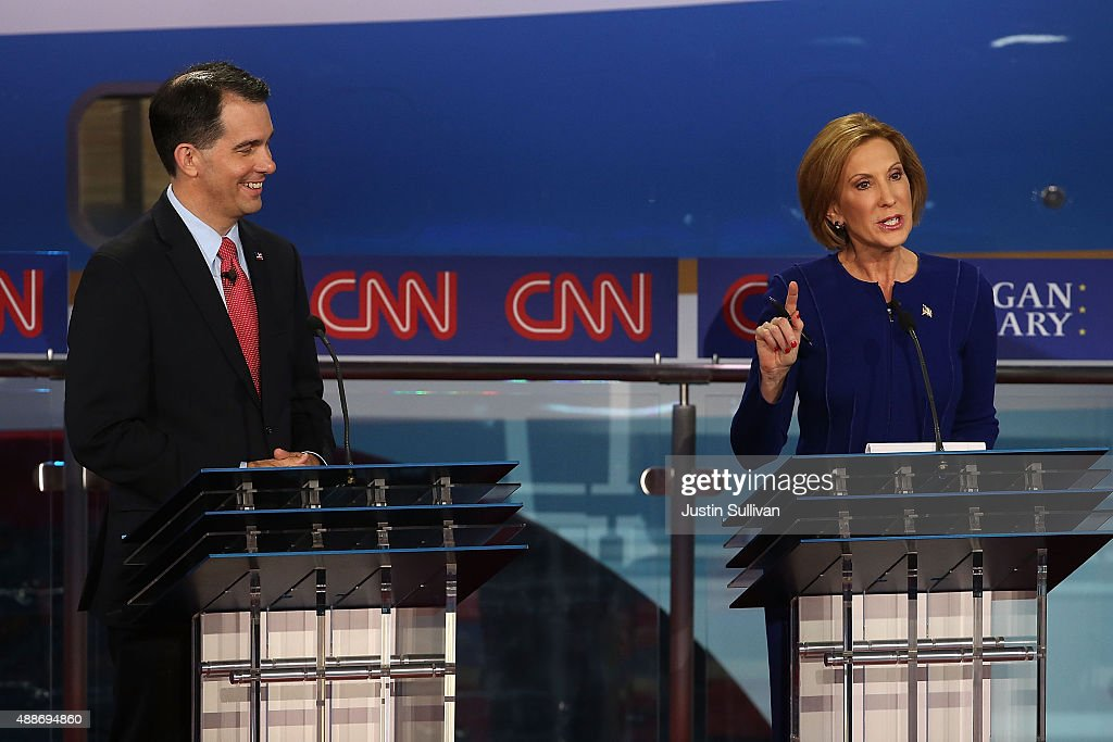 Republican presidential candidate Wisconsin Gov. <a gi-track='captionPersonalityLinkClicked' href=/galleries/search?phrase=Scott+Walker+-+Pol%C3%ADtico&family=editorial&specificpeople=7511934 ng-click='$event.stopPropagation()'>Scott Walker</a> (L) looks on as <a gi-track='captionPersonalityLinkClicked' href=/galleries/search?phrase=Carly+Fiorina&family=editorial&specificpeople=207075 ng-click='$event.stopPropagation()'>Carly Fiorina</a> speaks during the presidential debates at the Reagan Library on September 16, 2015 in Simi Valley, California. Fifteen Republican presidential candidates are participating in the second set of Republican presidential debates.