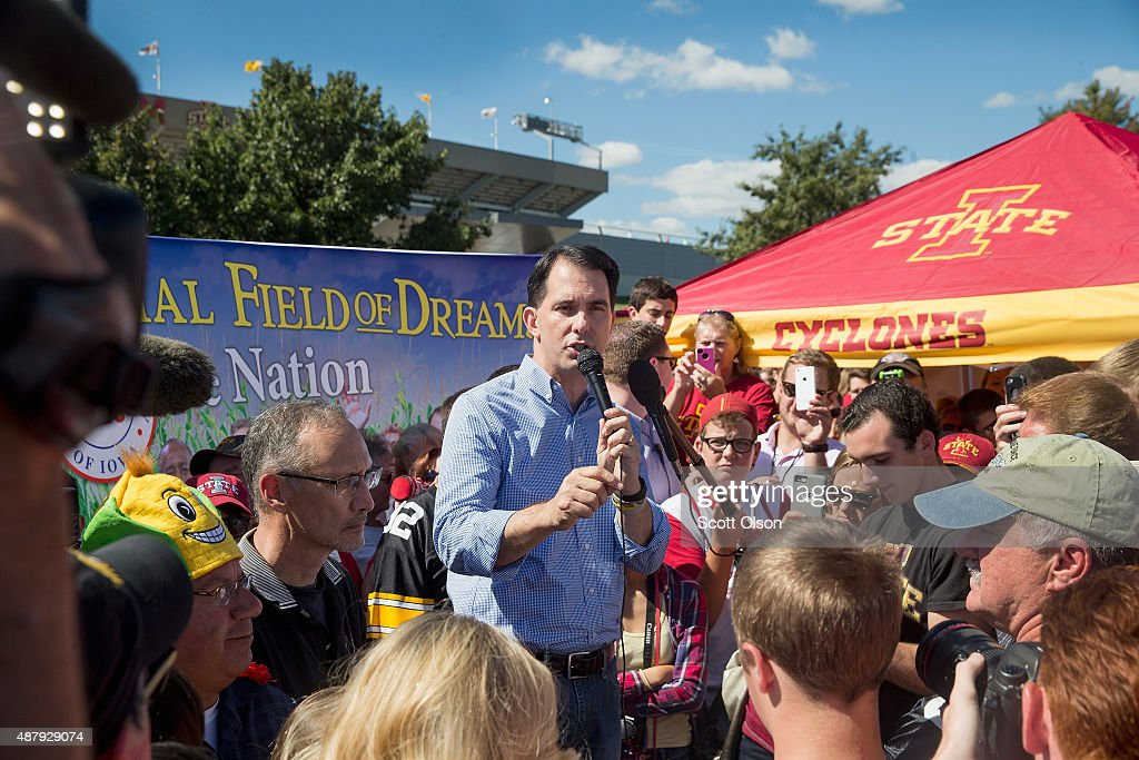 Republican presidential candidate, Wisconsin Gov. <a gi-track='captionPersonalityLinkClicked' href=/galleries/search?phrase=Scott+Walker+-+Pol%C3%ADtico&family=editorial&specificpeople=7511934 ng-click='$event.stopPropagation()'>Scott Walker</a> speaks to fans tailgating outside Jack Trice Stadium before the start of the Iowa State University versus University of Iowa football game on September 12, 2015 in Ames, Iowa. Several GOP candidates campaigned at the event.