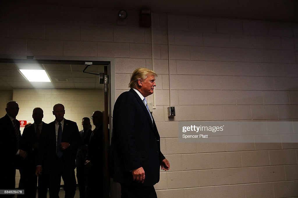 Republican presidential candidateDonald Trump walks into a a news conference before a rally on May 26, 2016 in Bismarck, North Dakota. According to a delegate count released Thursday, Trump has reached the number of delegates needed to win the GOP presidential nomination.