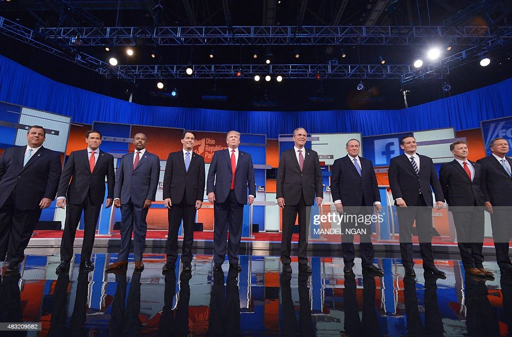 Republican presidential candidates arrive on stage for the Republican presidential debate on August 6 2015 at the Quicken Loans Arena in Cleveland...