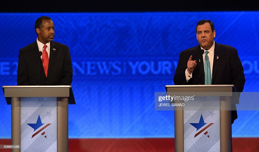 Republican presidential candidates Ben Carson (L) and Chris Christie (R) participate in the Republican Presidential Candidates Debate on February 6, 2016 at St. Anselm's College Institute of Politics in Manchester, New Hampshire. Seven Republicans campaigning to be US president are in a fight for survival in their last debate Saturday before the New Hampshire primary, battling to win over a significant number of undecided voters. / AFP / Jewel Samad