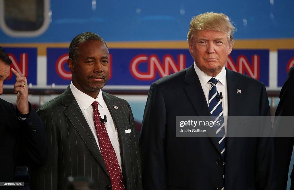 Republican presidential candidates Ben Carson and Donald Trump take part in the presidential debates at the Reagan Library on September 16 2015 in...