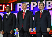 Republican presidential candidates Ben Carson Donald Trump and Sen Ted Cruz stand on stage during the CNN presidential debate at The Venetian Las...
