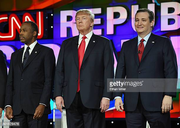 Republican presidential candidates Ben Carson Donald Trump and Sen Ted Cruz stand onstage during the CNN presidential debate at The Venetian Las...