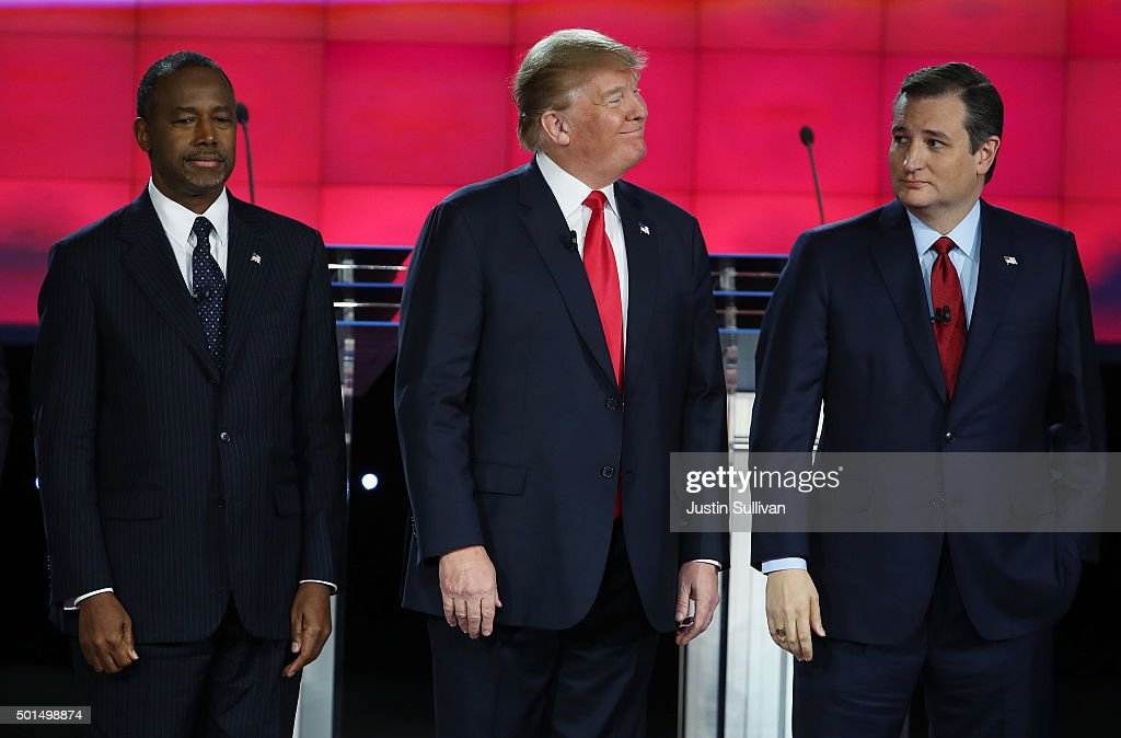 Republican presidential candidates Ben Carson, Donald Trump and U.S. Sen. Ted Cruz (R-TX) stand on stage during the CNN Republican presidential debate on December 15, 2015 in Las Vegas, Nevada. This is the last GOP debate of the year, with U.S. Sen. Ted Cruz (R-TX) gaining in the polls in Iowa and other early voting states and Donald Trump rising in national polls.