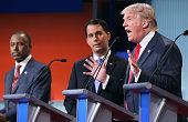 Republican presidential candidates Ben Carson Wisconsin Gov Scott Walker and Donald Trump participate in the first primetime presidential debate...