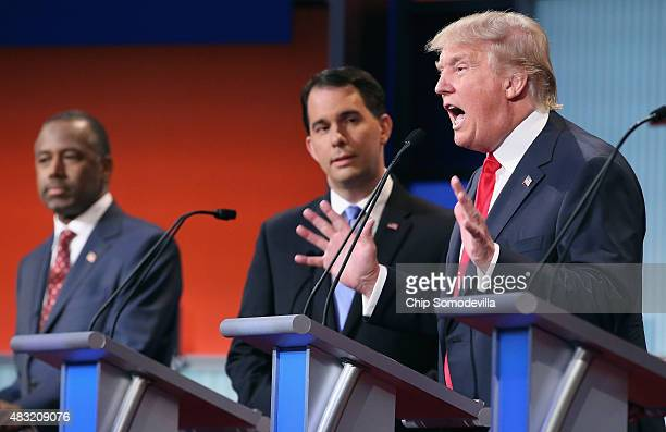 Republican presidential candidates Ben Carson Wisconsin Gov Scott Walker and Donald Trump participate in the first primetime presidential debate...
