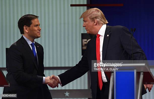Republican Presidential candidates businessman Donald Trump and Florida Senator Marco Rubio shake hands after the Republican Presidential debate...