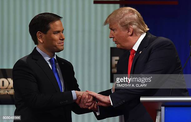 Republican Presidential candidates businessman Donald Trump and Florida Senator Marco Rubio shake hands after the Republican Presidential debate...