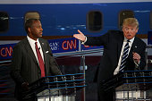Republican presidential candidates Donald Trump and Ben Carson take part in the presidential debates at the Reagan Library on September 16 2015 in...
