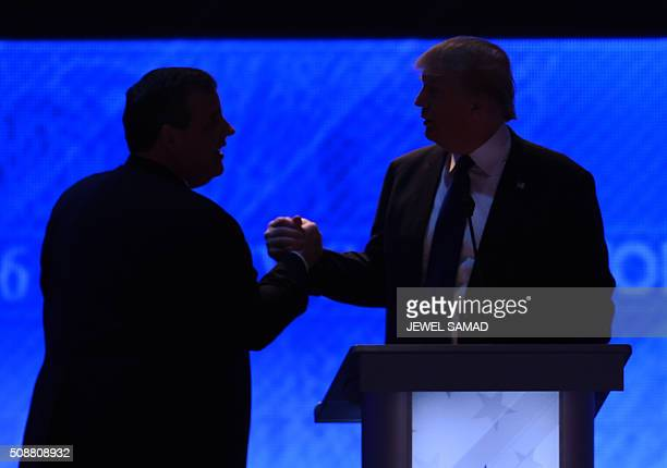 Republican presidential candidates Donald Trump and Chris Christie shake hands during a break in the Republican Presidential Candidates Debate on...