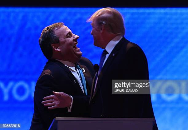 Republican presidential candidates Donald Trump and Chris Christie confer during a break in the Republican Presidential Candidates Debate February 6...