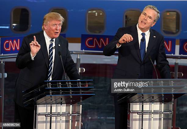 Republican presidential candidates Donald Trump and Jeb Bush argue during the republican presidential debates at the Reagan Library on September 16...