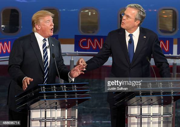 Republican presidential candidates Donald Trump and Jeb Bush argue during the presidential debates at the Reagan Library on September 16 2015 in Simi...