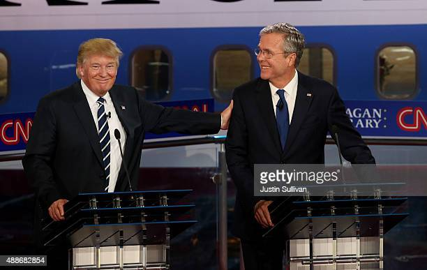 Republican presidential candidates Donald Trump and Jeb Bush take part in the presidential debates at the Reagan Library on September 16 2015 in Simi...