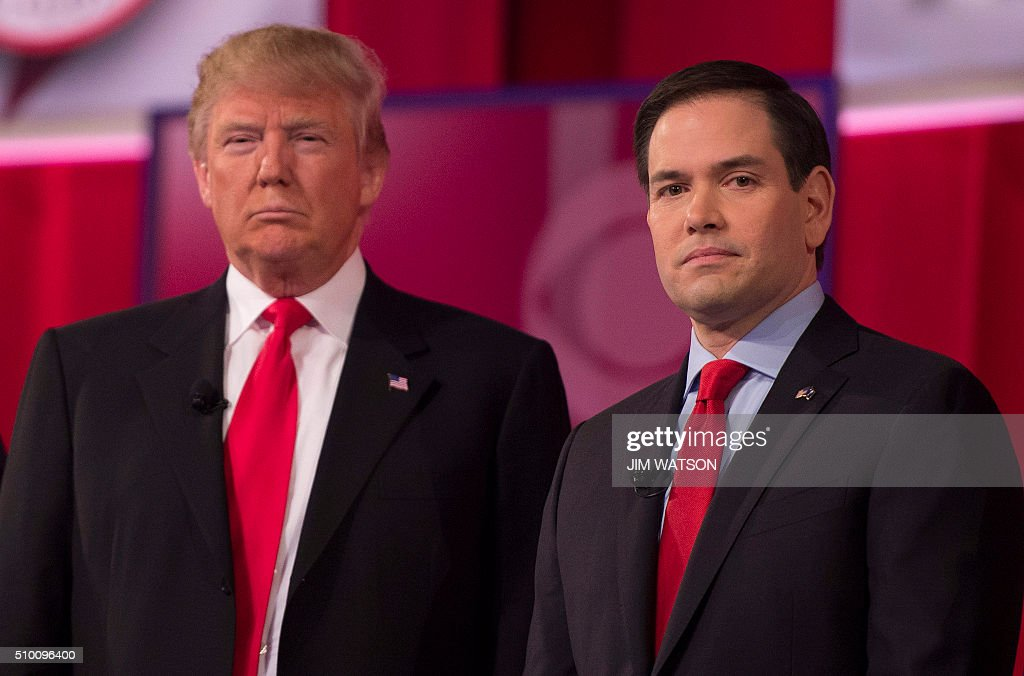 Republican presidential candidates Donald Trump (L) and Marco Rubio stand on stage during the CBS News Republican Presidential Debate in Greenville, South Carolina, February 13, 2016. / AFP / JIM WATSON