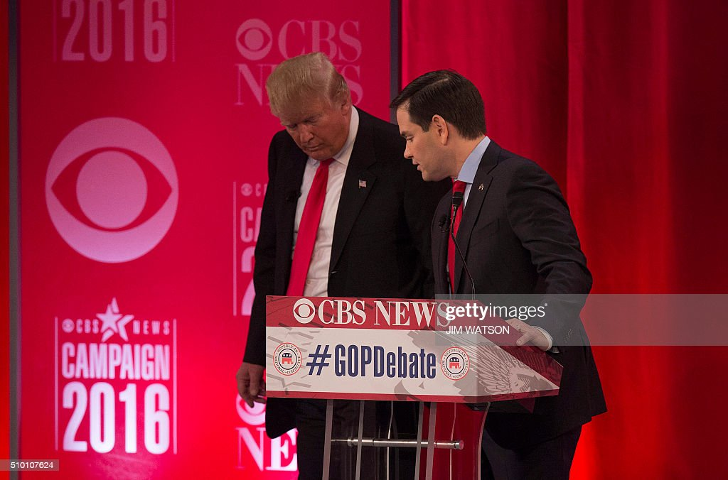 Republican presidential candidates Donald Trump (L) and Marco Rubio (R) talk during the CBS News Republican Presidential Debate in Greenville, South Carolina, February 13, 2016. / AFP / JIM WATSON