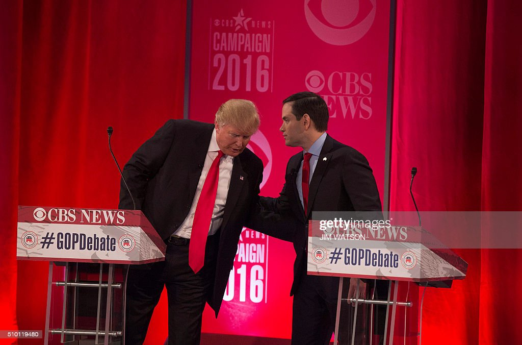 Republican presidential candidates Donald Trump (L) and Marco Rubio (R) following the CBS News Republican Presidential Debate in Greenville, South Carolina, February 13, 2016. / AFP / JIM WATSON