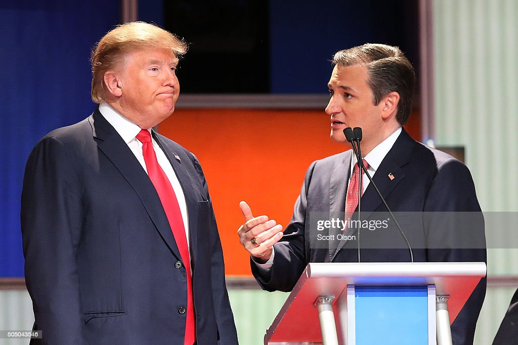 Republican presidential candidates (L-R) Donald Trump and Sen. <a gi-track='captionPersonalityLinkClicked' href=/galleries/search?phrase=Ted+Cruz&family=editorial&specificpeople=7222093 ng-click='$event.stopPropagation()'>Ted Cruz</a> (R-TX) speak during a commercial break in the Fox Business Network Republican presidential debate at the North Charleston Coliseum and Performing Arts Center on January 14, 2016 in North Charleston, South Carolina. The sixth Republican debate is held in two parts, one main debate for the top seven candidates, and another for three other candidates lower in the current polls.