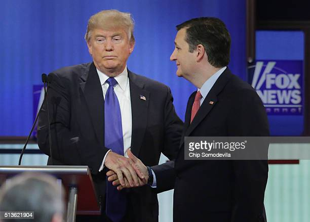 Republican presidential candidates Donald Trump and Sen Ted Cruz greet each following a debate sponsored by Fox News at the Fox theatre on March 3...