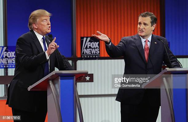 Republican presidential candidates Donald Trump and Sen Ted Cruz participate in a debate sponsored by Fox News at the Fox Theatre on March 3 2016 in...