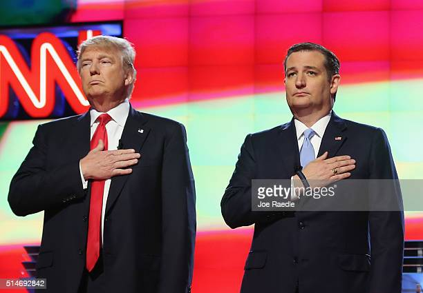 Republican presidential candidates Donald Trump and Sen Ted Cruz listen to the national anthem before the start of the CNN Salem Media Group The...