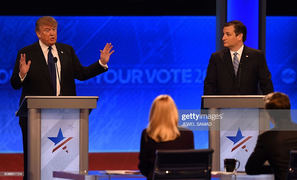 Republican presidential candidates Donald Trump (L) and Ted Cruz (R) participate in the Republican Presidential Candidates Debate on February 6, 2016 at St. Anselm's College Institute of Politics in Manchester, New Hampshire. Seven Republicans campaigning to be US president are in a fight for survival in their last debate Saturday before the New Hampshire primary, battling to win over a significant number of undecided voters. / AFP / Jewel Samad