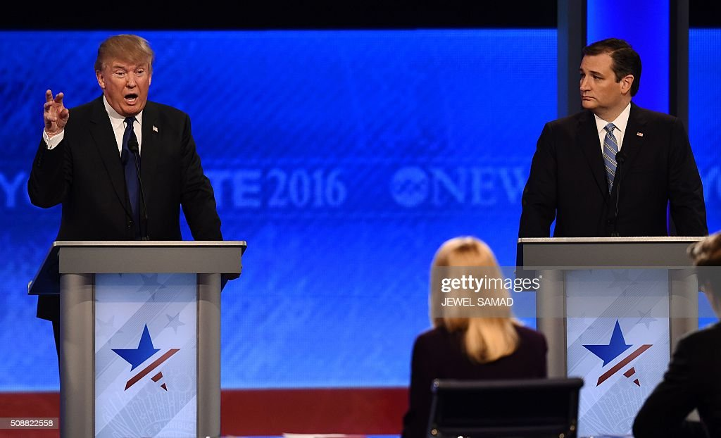 Republican presidential candidates Donald Trump (L) and Ted Cruz (R) participate in the Republican Presidential Candidates Debate February 6, 2016 at St. Anselm's College Institute of Politics in Manchester, New Hampshire. Seven Republicans campaigning to be US president are in a fight for survival in their last debate Saturday before the New Hampshire primary, battling to win over a significant number of undecided voters. / AFP / Jewel Samad