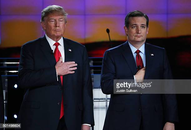 Republican presidential candidates Donald Trump and US Sen Ted Cruz hold their hands over their hearts during the National Anthem during the CNN...