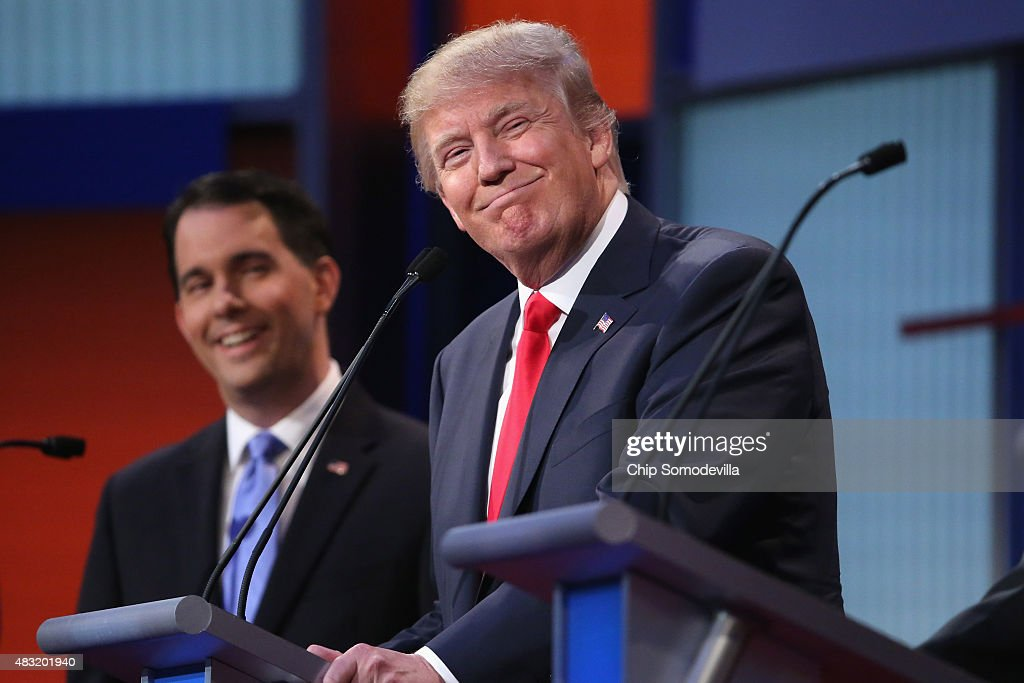 Republican presidential candidates Donald Trump (R) and Wisconsin Gov. <a gi-track='captionPersonalityLinkClicked' href=/galleries/search?phrase=Scott+Walker+-+Politiek&family=editorial&specificpeople=7511934 ng-click='$event.stopPropagation()'>Scott Walker</a> participate in the first prime-time presidential debate hosted by FOX News and Facebook at the Quicken Loans Arena August 6, 2015 in Cleveland, Ohio. The top-ten GOP candidates were selected to participate in the debate based on their rank in an average of the five most recent national political polls.